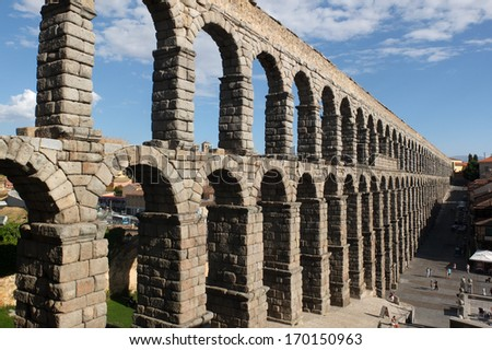SEGOVIA, SPAIN -  SEPTEMBER 24:  Famous Roman aqueduct, on September 24, 2013, in Segovia, Spain.   - stock photo