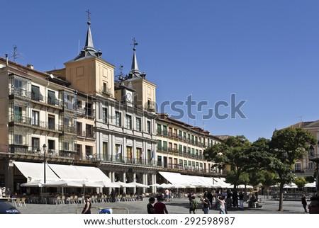 SEGOVIA, SPAIN - SEPTEMBER 14, 2014: Tourists and locals alike enjoying life in Plaza Mayor, Segovia, Spain - stock photo