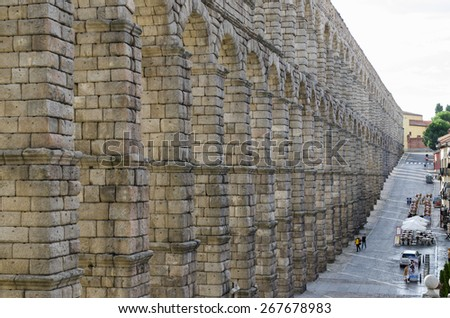 SEGOVIA, SPAIN - SEPTEMBER 20, 2014: View from one of the side stairs, the Roman aqueduct in the city, heritage of humanity. - stock photo
