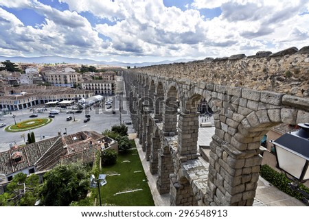 SEGOVIA, SPAIN - SEPTEMBER 14, 2014: View of the old town and the roman aqueduct in Segovia, Spain - stock photo