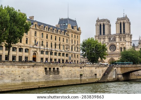 Seine and Notre Dame de Paris cathedral is one of the most visited places in France in a summer day - stock photo