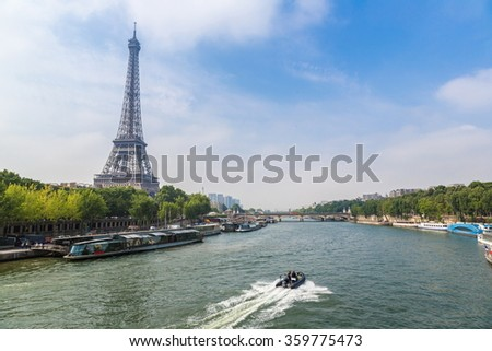 Seine in Paris and Eiffel tower in beautiful summer day in Paris, - stock photo