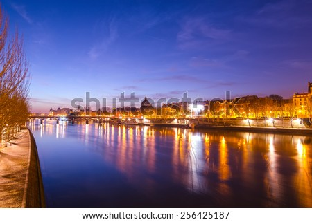 Seine river and Old Town of Paris (France) in the sunrise - stock photo