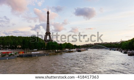 Seine river in Paris with Eiffel tower at sunset in France. Paris scene. Eiffel tower view in Paris, France. Walking in Paris. Sunset view from Seine river on Eiffel tower in Paris. Paris sunset. - stock photo