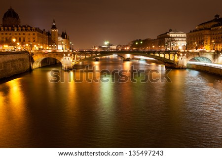 Seine river with pont notre dame and pont au change in Paris at night - stock photo