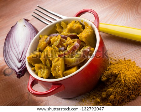 seitan stew with curry and onions - stock photo