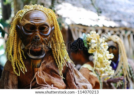 SELANGOR,MALAYSIA - 22 FEBRUARY : An unidentified man wearing a wooden mask for the Mahyin Jo-oh dance during the Ari Moyang celebration on February 22, 2012 in Selangor, Malaysia. - stock photo