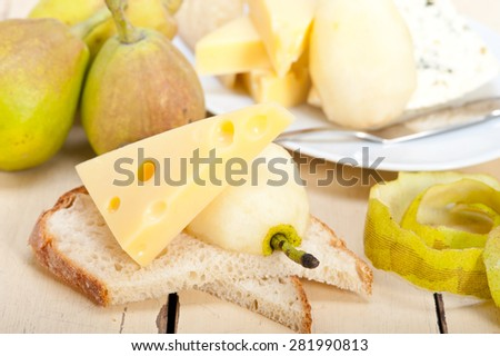 selection of cheese and fresh pears appetizer snack - stock photo