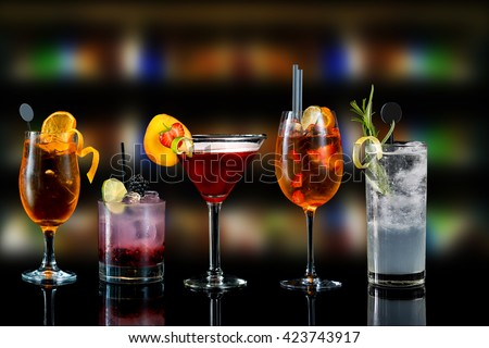 Selection of cocktails martini spritz bramble gin tonic bar blurred background - stock photo
