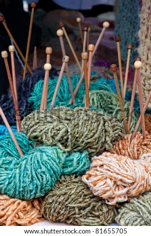 selection of colored wool with knitting needles - stock photo