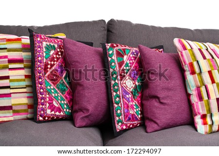 Selection of colorful cushions on a sofa - stock photo
