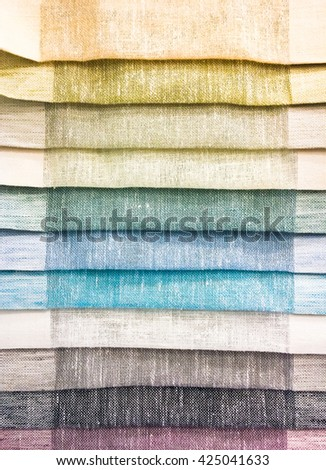 Selection of colourful fabrics - stock photo