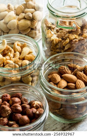 Selection of dried fruits in jars  - stock photo