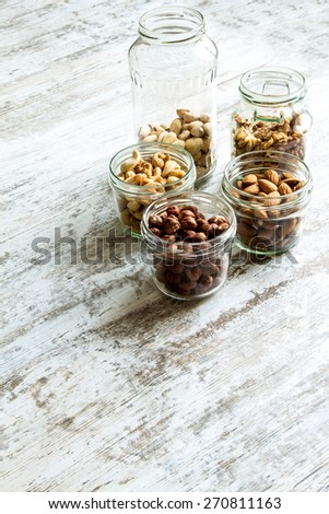 Selection of dried fruits in jars background