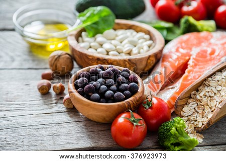 Selection of food that is good for the heart, rustic wood background - stock photo