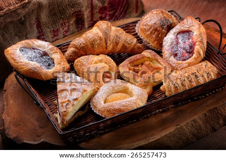 Selection of French & Danish pastries on a Wicker basket  - stock photo