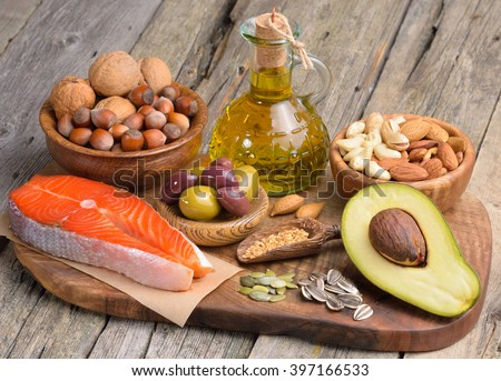 Selection of healthy fat sources on wooden table.  - stock photo