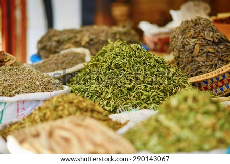 Selection of herbs on a traditional Moroccan market (souk) in Fes, Morocco - stock photo