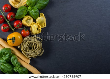 Selection of italian typical food on black background from above - stock photo