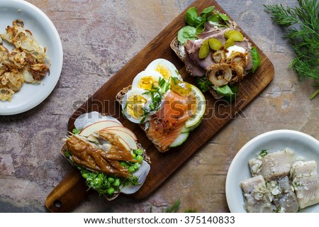Selection of Nordic open sandwiches with salmon, mackerel and beef - stock photo