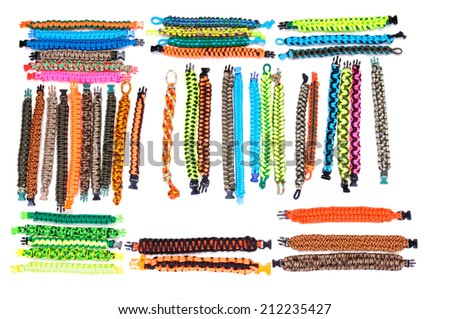 Selection of Parachute cord bracelets with a variety of colors and weaves on a white background - stock photo