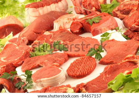 Selection of raw meats - stock photo