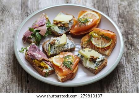 Selection of Scandinavian open sandwiches - stock photo