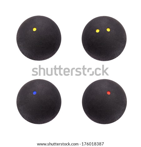 Selection of squash balls isolated over white background - stock photo