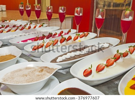Selection of sweet desserts on display at a luxury restaurant buffet bar  - stock photo