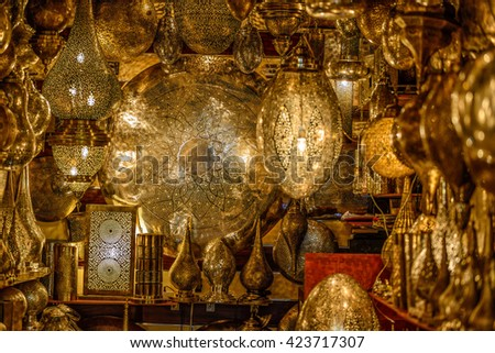Selection of traditional lamps on sale at a market stall in souks of Marrakech, Morocco. - stock photo