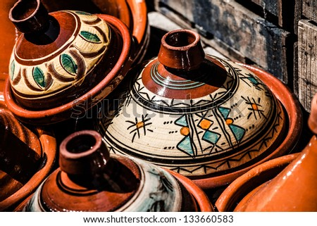 Selection of very colorful Moroccan tajines (traditional casserole dishes) - stock photo
