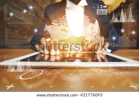 Selective focus. Close up of black man's hands holding digital tablet with reflective touchscreen surface, using high-speed Internet connection while relaxing at the student's cafe after classes - stock photo
