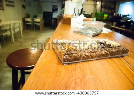 selective focus coffee beans in a variety of roasts light to dark, in a box on coffee table bar in Chaing mai,Thailand - stock photo