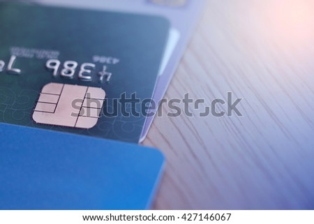 Selective focus credit card with gradient filter,Credit card close up shot,Credit card background with copy space. - stock photo