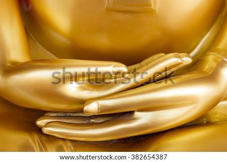 Selective Focus :  Hands of Golden Buddha statue - stock photo