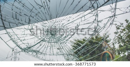 Selective focus image on Broken car windshield take photo from inside from accident of car. - stock photo