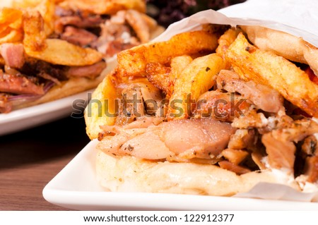 Selective focus in the middle of gyros pita - stock photo