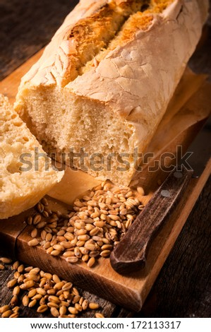 Selective focus in the middle of homemade bread on wooden board - stock photo