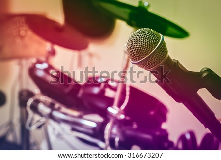 Selective focus microphone on blur drum background by vintage tone and vignetting. - stock photo