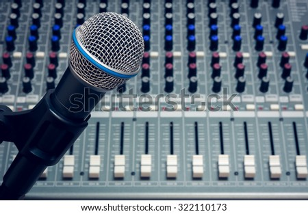 selective focus microphone on the blur sound mixer background. - stock photo