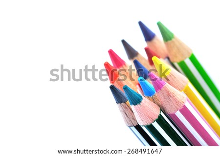 Selective focus of bunch of color pencils with stripe, white background   - stock photo