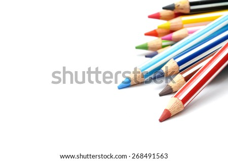 Selective focus of Color pencils with stripe, white background with copy space - stock photo