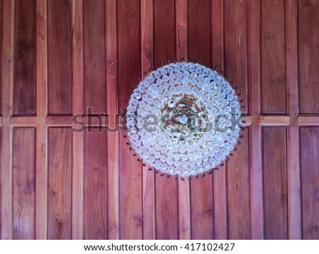 selective focus of Crystal Chandelier , Chandelier ceiling lights on wooden background - stock photo