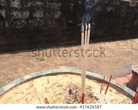 selective focus of  joss stick pot ; incense burner  - stock photo