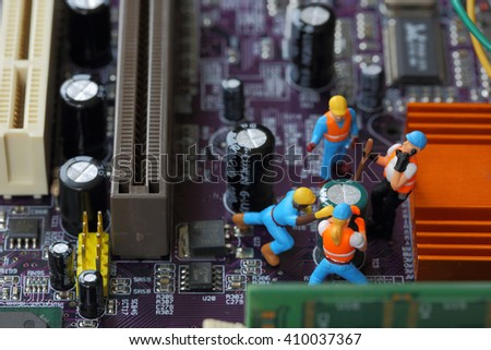 Selective focus of miniature engineer and worker fixed and  mainboard computer and use for business background. - stock photo