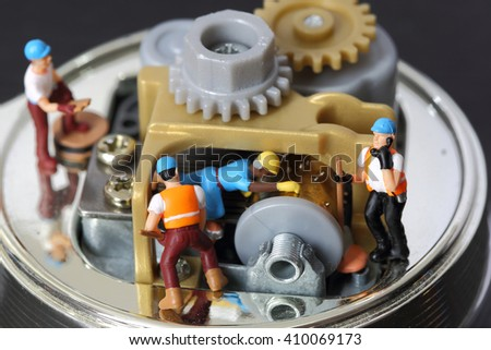 Selective focus of miniature engineer and worker fixed and repair musical box and use for business background. - stock photo