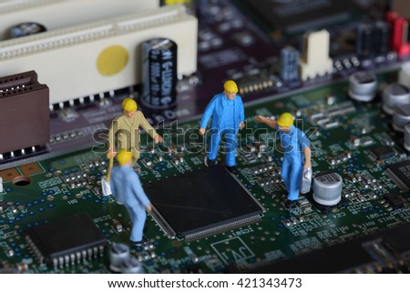 Selective focus of miniature engineer meeting and worker fixed problem mainboard computer and use for business background. - stock photo