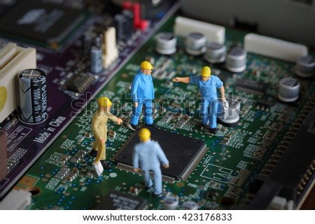 Selective focus of miniature engineer meeting, worker fixed problem and repair chip mainboard computer and use for business background. - stock photo