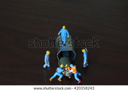 Selective focus of miniature flowman control engineer and worker fixed and Small electric motor and use for business background. - stock photo