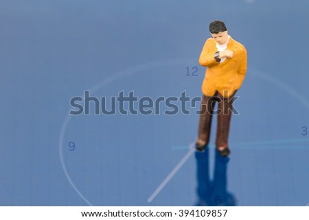 selective focus of miniature people on blue clock ,abstract background to time management. - stock photo